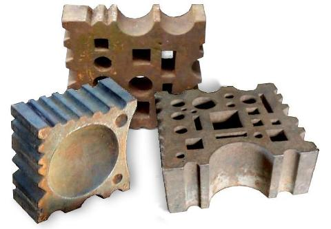 Group of three iron swage blocks
